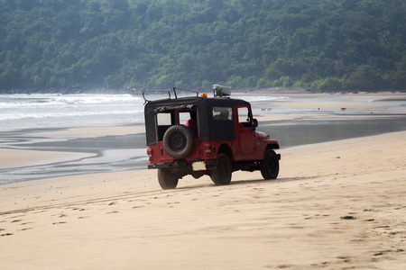 life saving: AGONDA, INDIA - OCTOBER 13, 2015: Lifeguard jeep at Agonda beach in India. Goa Surf Life Saving employs 429 Certified Beach Lifeguards. Editorial