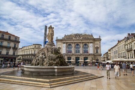 MONTPELLIER, FRANCE - JULY 13, 2015: The three graces fountain at Place de la Comedie. Fountain Three Graces, built by sculptor Etienne d'Antoine in 1790. Zdjęcie Seryjne - 53641858