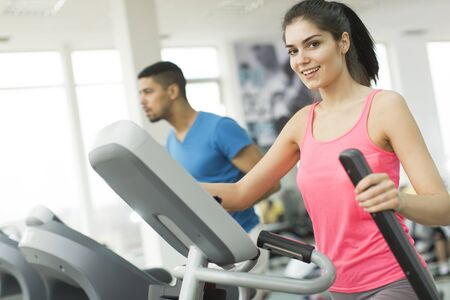 treadmill: Young multiracial people training in the gym