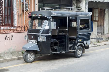 bajaj: COLOMBO, SRI LANKA - JANUARY 23, 2014: Auto rickshaw or tuk-tuk on the street of Colombo. Most tuk-tuks in Sri Lanka are a slightly modified Indian Bajaj model, imported from India.