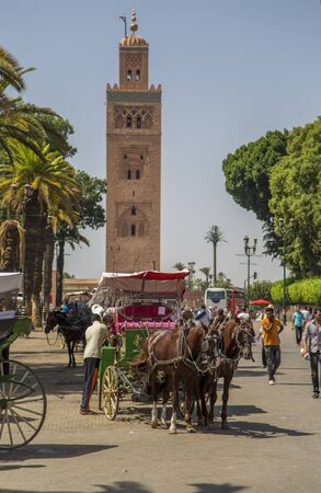 marrakesh: MARRAKESH, MOROCCO - SEPTEMBER 12, 2015: Unidentified people on the street of Marrakesh, Morocco. Marrakesh is the fourth largest city in Morocco.