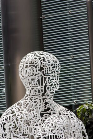 SINGAPORE - AUGUST 6, 2014: Sculpture Singapore Soul in Singapore. It was designed by Jaume Plensa at 2011.