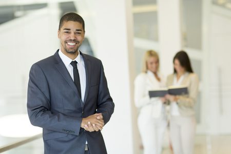 african american woman business: Young multiracial people working in the office