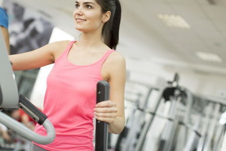 crosstrainer: Woman training on a cross trainer in the gym Stock Photo