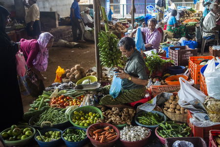 common market: VARKALA, INDIA - OCTOBER 18, 2015: Unidentified vendors wait for customers in a crowded market.