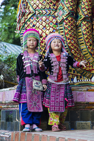 cultural and ethnic clothing: CHIANG MAI, THAILAND- JANUARY 31, 2016: Unidentified children in hilltribe costume at Wat Phra Doi Suthep, near Chiang Mai. Wat Phra Doi Suthep is on top of a mountain just outside Chiang Mai, one of the most important and extravagant of all Thailands Bu
