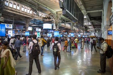 terminus: MUMBAI, INDIA - OCTOBER 9,  2015:  Unidentified people at platform of Chhatrapati Shivaji  erminus railway station in Mumbai, India. Chhatrapati Shivaji Terminus, is a UNESCO World Heritage Site and an historic railway station in Mumbai Maharashtra, India Editorial