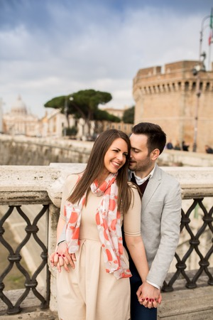 castel: Loving couple by the Castel SantAngelo in Rome, Italy Stock Photo