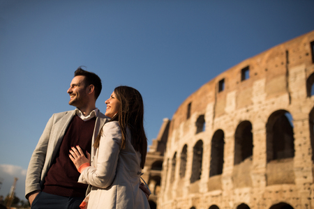 Loving couple in front of the Colosseum in Rome Reklamní fotografie