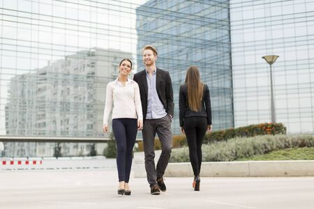 teammates: Businesspeople walking together in front of the building