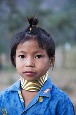 thai stretch: CHIANG MAI, THAILAND - FEBRUARY 01, 2016: Unidentified girl from Karen Long Neck Village near Chiang Mai, Thailand. This village is a part of very popular Hill tribe tourism in Thailand.