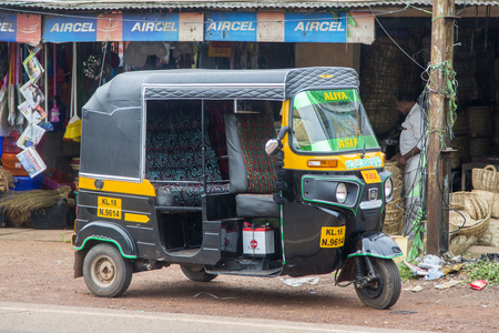 three wheeler: VARKALA, INDIA - OCTOBER 18, 2015: Auto rickshaw in Varkala. Auto rickshaws are used in cities and towns for short distances and they provide cheap and efficient transportation. Editorial