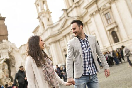 navona: Loving couple walking at the Piazza Navona in Rome