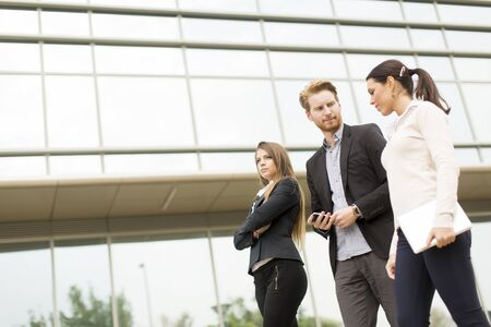 Businesspeople walking together in front of the building