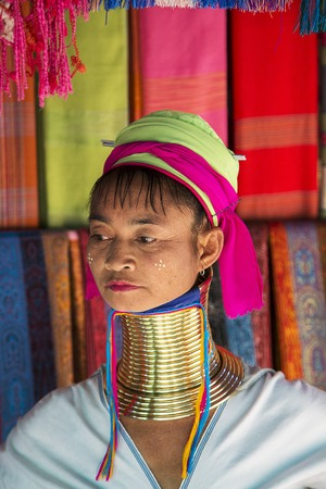 thai stretch: CHIANG MAI, THAILAND - FEBRUARY 01, 2016: Unidentified woman from Karen Long Neck Village near Chiang Mai, Thailand. This village is a part of very popular Hill tribe tourism in Thailand.