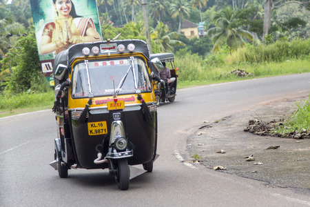 varkala: VARKALA, INDIA - OCTOBER 18, 2015: Auto rickshaw in Varkala. Auto rickshaws are used in cities and towns for short distances and they provide cheap and efficient transportation. Editorial
