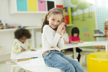 gesticulation: Face expression and gesticulation of a little girl in the kindergarten Stock Photo