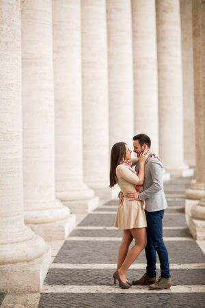 Loving couple at the St. Peter's Square in Vatican Stock Photo