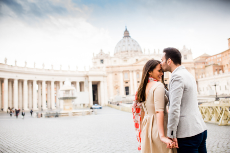 st  peter's square: Loving couple at the St. Peters Square in Vatican Stock Photo