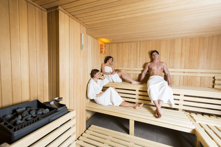 sauna: People relaxing on the bench in the sauna