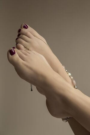 footcare: Close view of the female feet with a bracelet