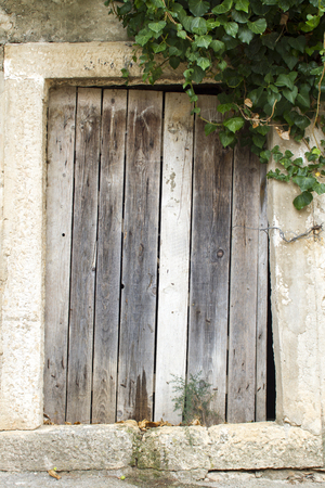 neglected: Close view of the neglected wooden door Stock Photo