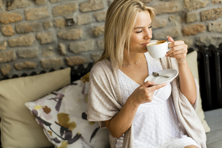 cofe: Young woman enjoying in  the cofe drinking coffee Stock Photo