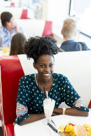african american woman: Young african american woman in the diner Stock Photo