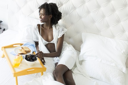 sexy black woman: African american woman in white on the bed