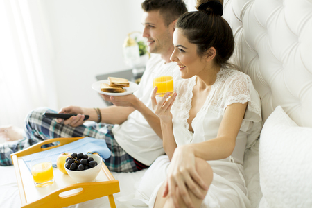 Young couple having a breakfast in the bed