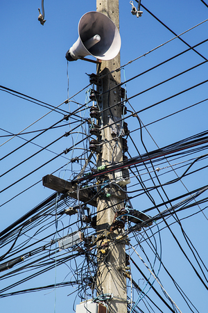 wire mess: Messy electrical cables in Chiang Mai, Thailand Stock Photo