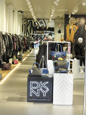 donna: ALBERTA, CANADA - SEPTEMBER 21, 2014: Interior of the DKNY store. DKNY is a New York-based fashion house specializing in fashion goods for men and women founded in 1984 by Donna Karan.