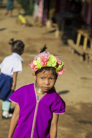 thai stretch: CHIANG MAI, THAILAND - FEBRUARY 02, 2016: Unidentified girl from Karen Long Neck Village near Chiang Mai, Thailand. This village is a part of very popular Hill tribe tourism in Thailand.