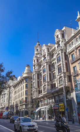 gran via: MADRID, SPAIN - MARCH 16, 2016: Unidentified people at Gran Via in Madrid. Its the oldest and main shopping street in Madrid.