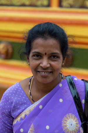 sri lanka temple: MATALE, SRI LANKA - JANUARY 27, 2014: Unidentified woman in front of hindu temple Sri Muthumariamman Thevasthanam at Matale, Sri Lanka. Temple was established in 1852 by the Indian workers from South India.
