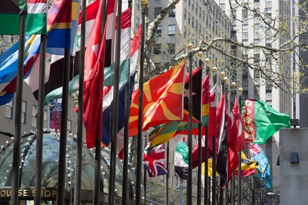 flagpoles: NEW YORK, USA - APRIL 21, 2016: Flagpoles display flags of United Nations member countries around the Rockefeller plaza. There are some 200 of them. Editorial