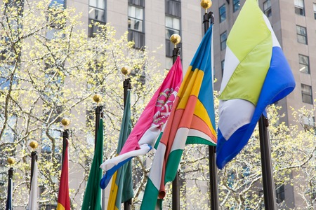 flagpoles: Various flags on a flagpoles on the street