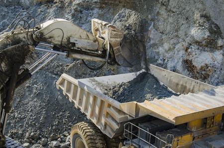 open pit: Dump truck in the open pit mine
