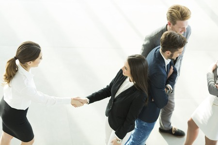 View from above of the businesswomen shaking hands in the office