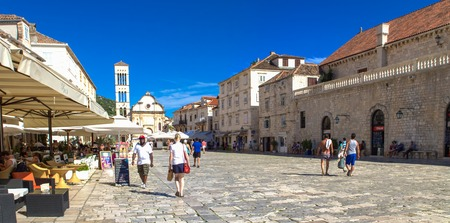 pharos: HVAR, CROATIA - JULY 1, 2009: Unidentified people on the street of Stari Grad, Hvar, Croatia. Stari Grad (Pharos) is the oldest town in Croatia.