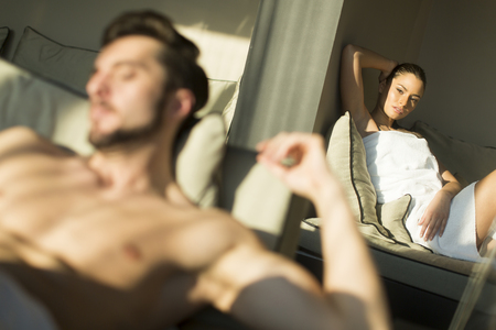 sexual intimacy: Young couple relaxing in the room