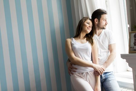 Loving couple by the window Stock Photo