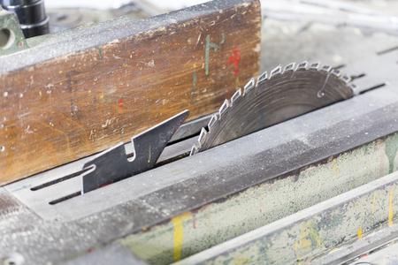 woodcutting: Close view of the circular wood-cutting saw