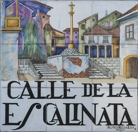 depict: MADRID, SPAIN - MARCH 13, 2016 : Closeup of the street sign. Street signs in Madrid are hand-painted ceramic tiles typically composed within 9 or 12 tiles. They depict the name of the alley or street. Editorial