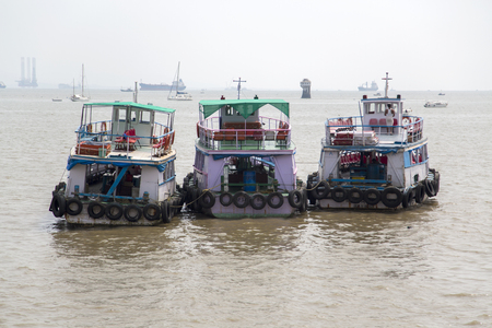 government services: MUMBAI, INDIA - OCTOBER 9, 2015: Ferries in Mumbai. Water transport in Mumbai consists mostly of ferries. Services are provided by both government agencies as well as private partners. Editorial