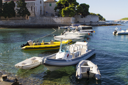 starigrad: HVAR, CROATIA - JULY 15, 2015: Boats at Hvar island in Croatia. Hvar is a popular travel destination on Adriatic sea, Croatia