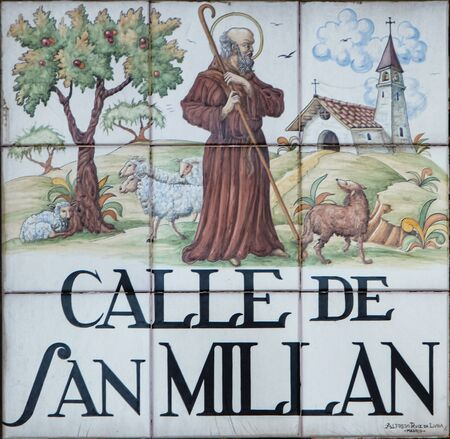 millan: MADRID, SPAIN - MARCH 13, 2016 : Closeup of the street sign. Street signs in Madrid are hand-painted ceramic tiles typically composed within 9 or 12 tiles. They depict the name of the alley or street. Editorial