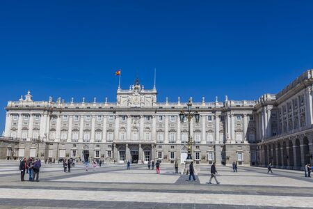 ini: MADRID, SPAIN - MARCH 13, 2016: Unidentified people by Royal Palace ini Madrid, Spain. Palacio Real de Madrid is official residence of Spanish Royal Family at Madrid
