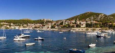 pharos: STARI GRAD, CROATIA - SEPTEMBER 8, 2014: Boats at marina ini Stari Grad on Hvar island, Croatia. Stari Grad (Pharos) is the oldest town in Croatia and one of the oldest towns in Europe Editorial