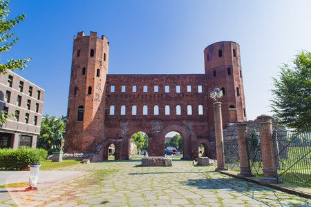 View at old Roman Palatine Gate in Turin, Italy